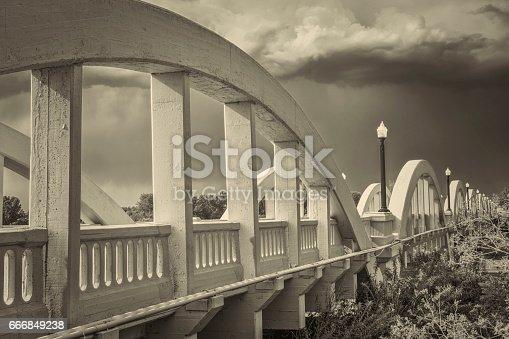 Rainbow arch bridge over South Platte River in Fort Morgan, Colorado, retro sepia toning