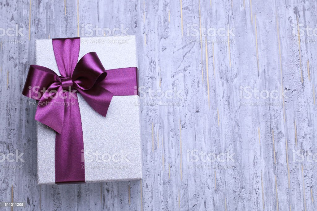 Concrete background with gift boxes, top view - studio shot stock photo