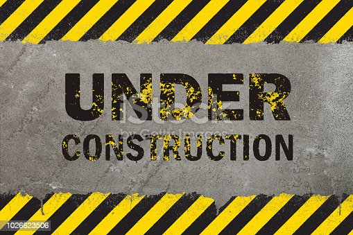 istock Concrete background with grunge hazard sign 1026623506