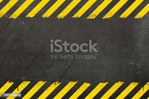 istock Concrete background with grunge hazard sign 1063295848