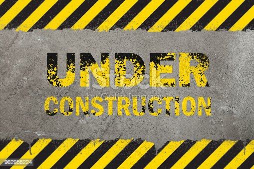 istock Concrete background with grunge hazard sign 962958224