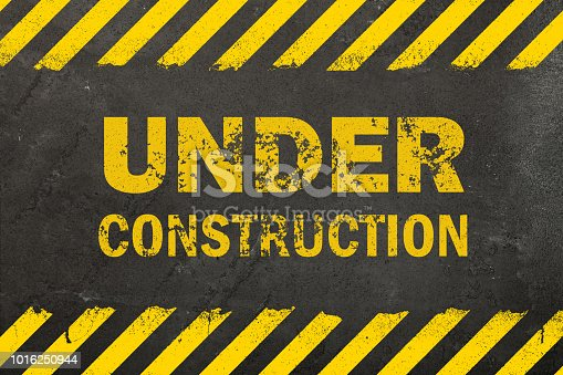 istock Concrete background with under construction sign 1016250944