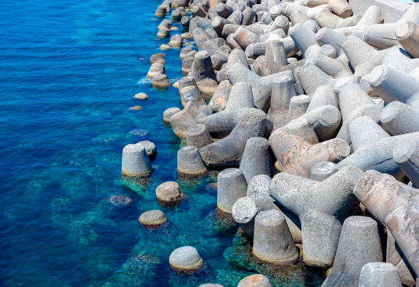 concrete block breakwater (tetrapod) port of the S. Maria di Lesina concrete block breakwater (tetrapod) port of the S. Maria di Lesina. Apulia Italy groyne stock pictures, royalty-free photos & images
