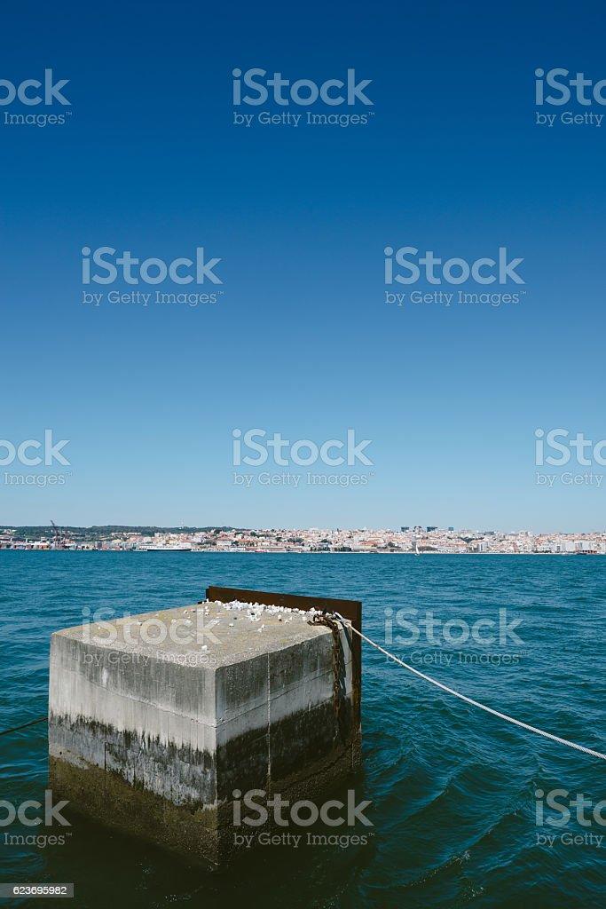 Concrete block in river Tejo - Lisboa stock photo