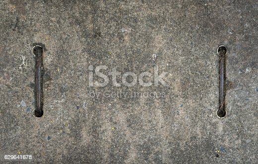 Concrete block sewer with metal handle for background.