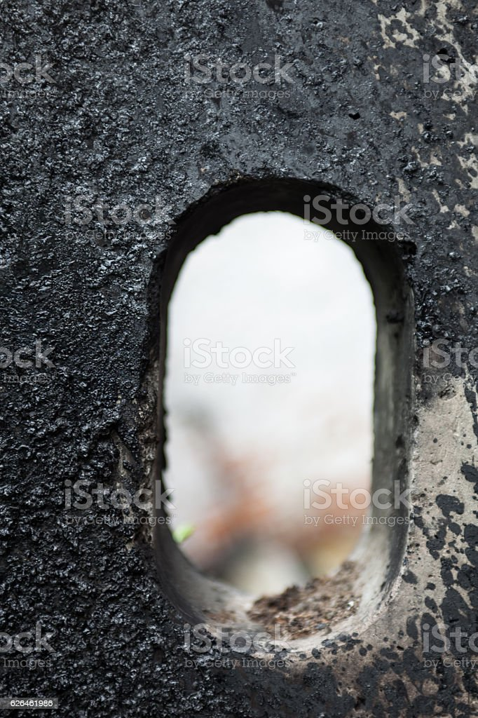 Concrete block stained with black tar stock photo