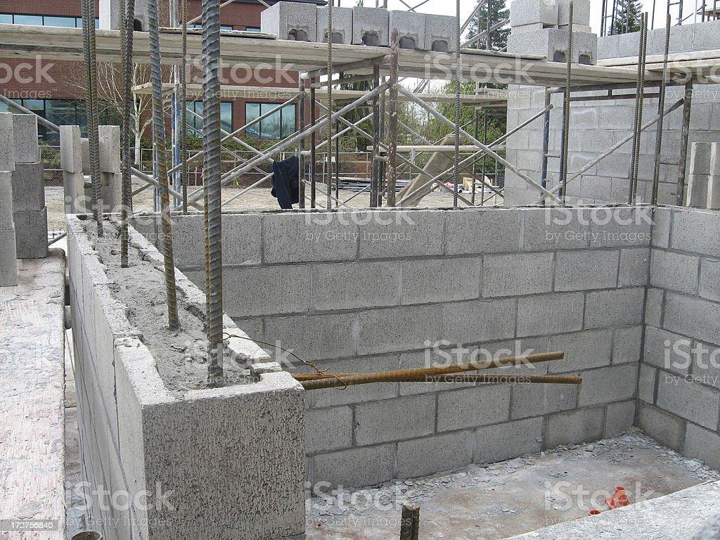 Concrete block wall construction stock photo more for Concrete block building plans