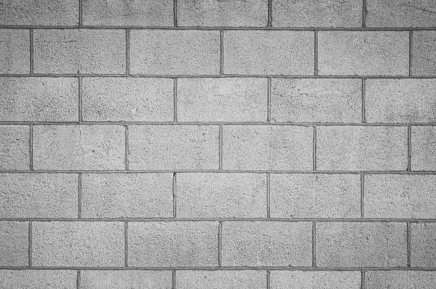 Concrete block wall seamless background and texture stock photo