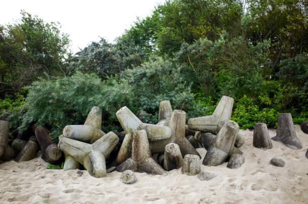 Betonwellenbrecher auf den Strand - in Form von Sternen - Tetrapoden – Foto