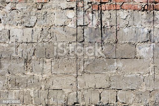 611897876istockphoto Concrete brick wall background 849226592
