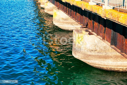 Concrete bridge columns in the river water