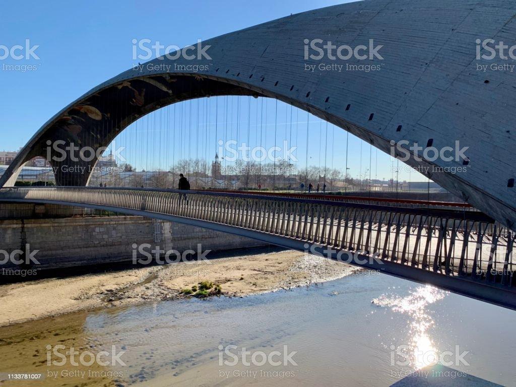 Concrete bridge with river at Madrid Río Park. stock photo