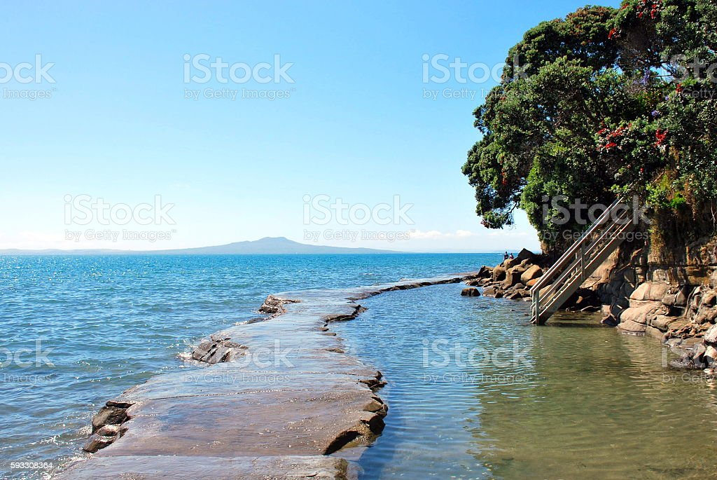Concrete Causeway from Mairangi Bay, North Shore City, Auckland, NZ stock photo