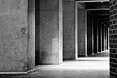 Concrete Column Corridor in Black and White