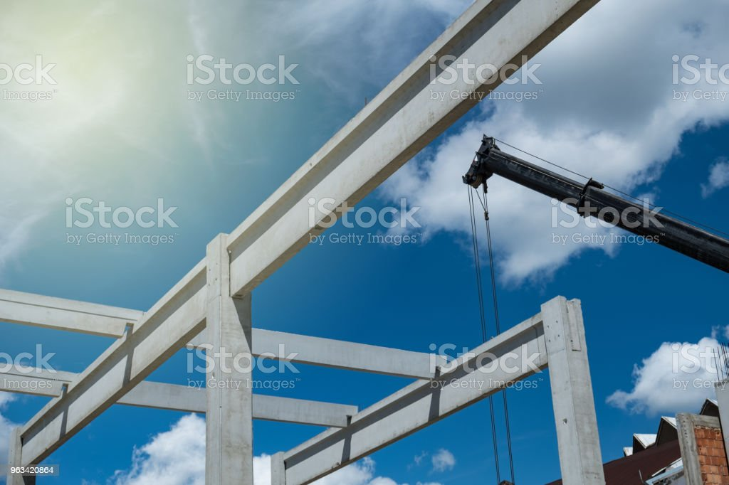 Concrete construction lifted by crane stock photo