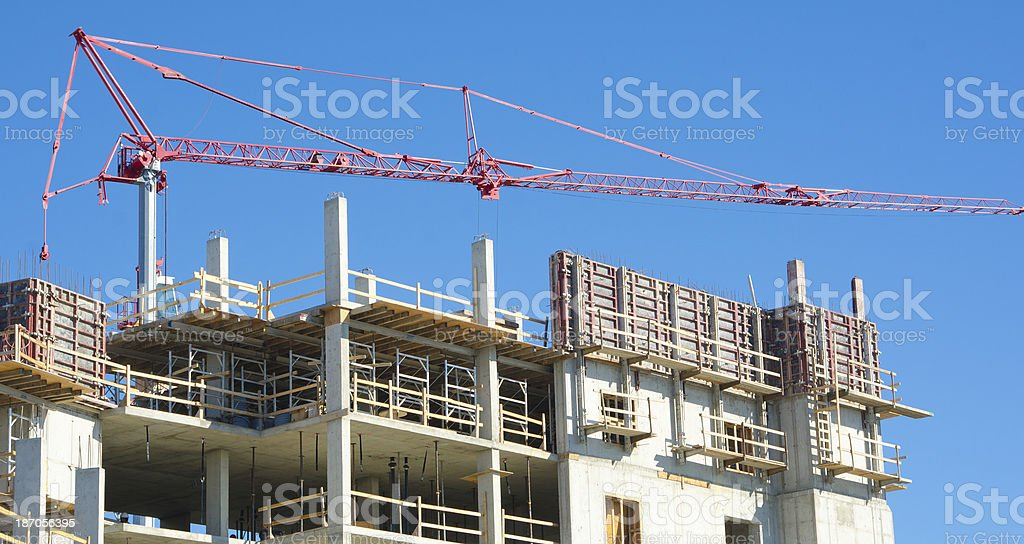 Concrete Construction Site with Tower Crane royalty-free stock photo