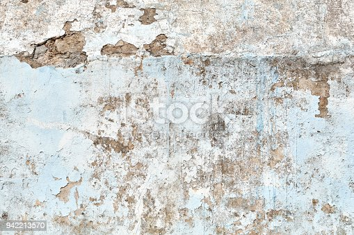 Concrete cracked wall with blue and rust color in it