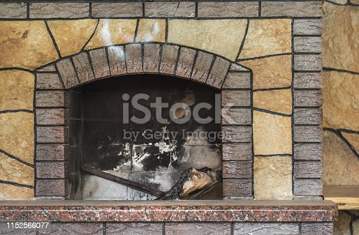 istock Concrete dirty fireplace with remains of ash after wooden firewood burnt in fireplace 1152566077