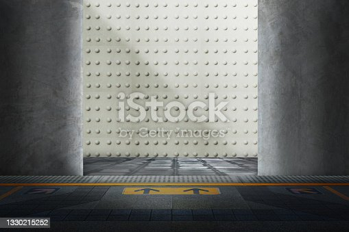 istock Concrete door open to room where the wall are patterned with round buttons and floor in front has arrows indicating the entrance Abstract background illustrations from photographs 1330215252