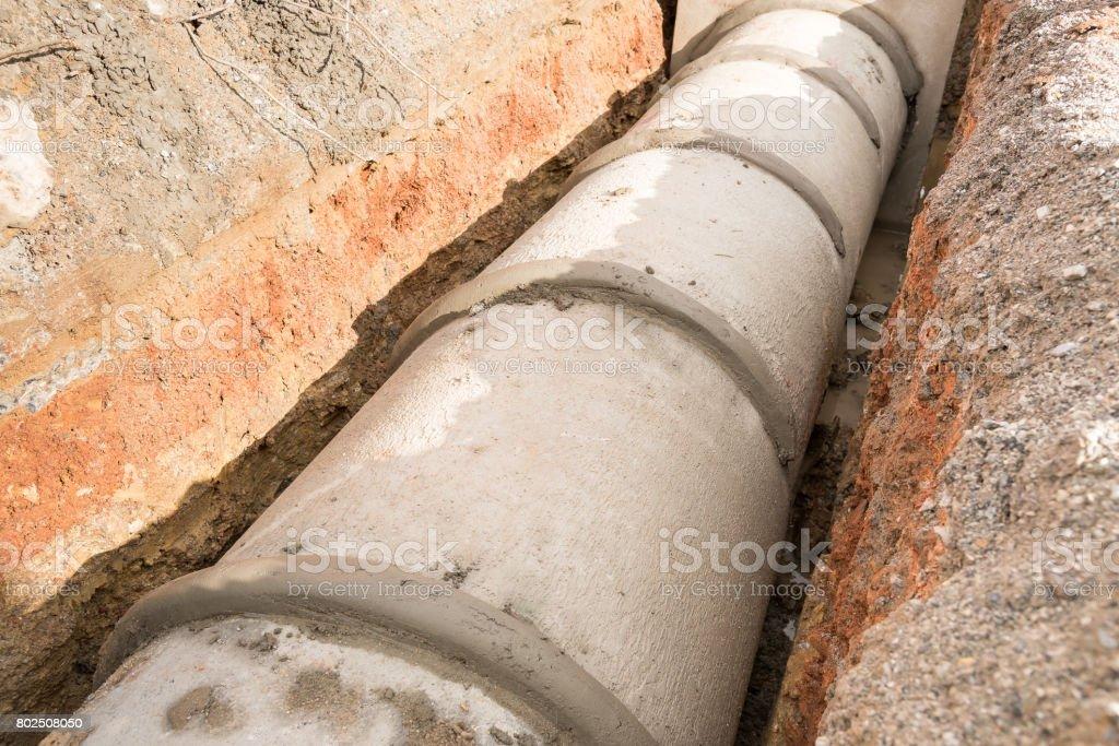 Concrete drainage pipe and manhole stock photo