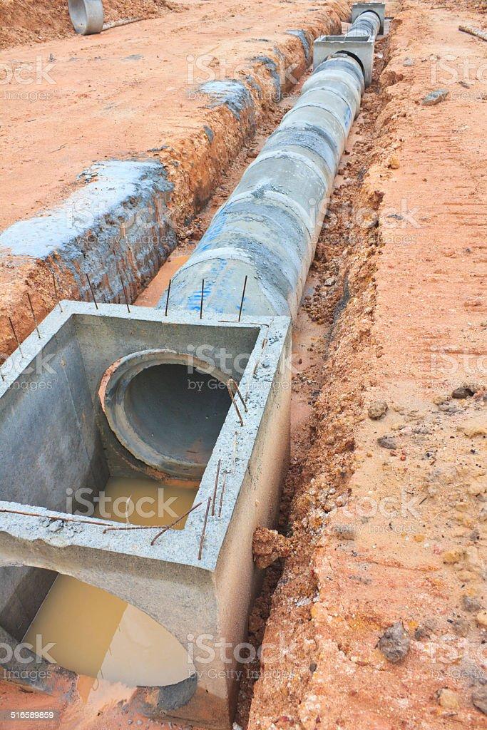 Concrete drainage tank on construction site stock photo