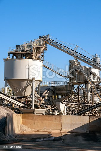 Construction industry concrete plant structure on a clear blue sky