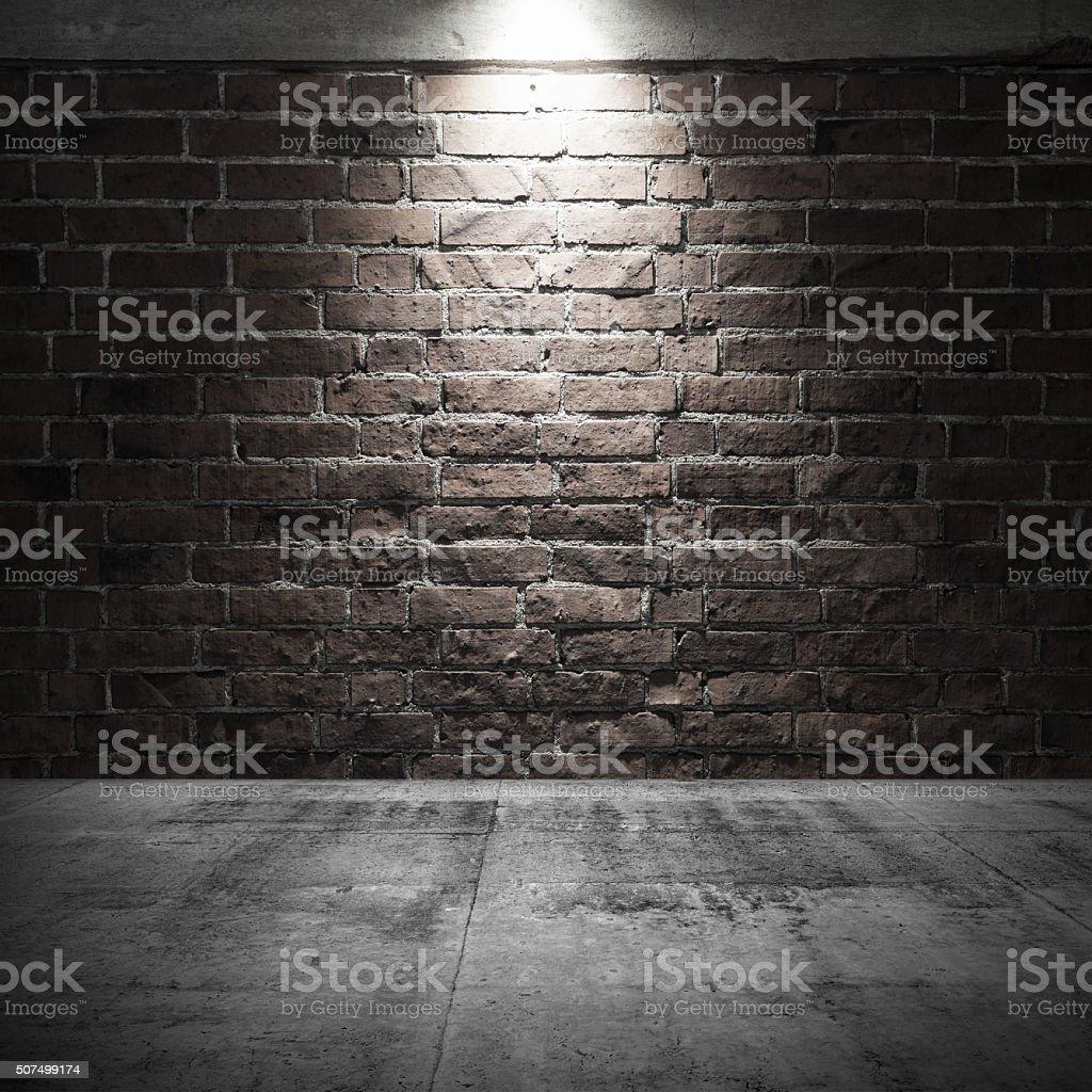 Concrete floor and brick wall with spot light illumination stock photo