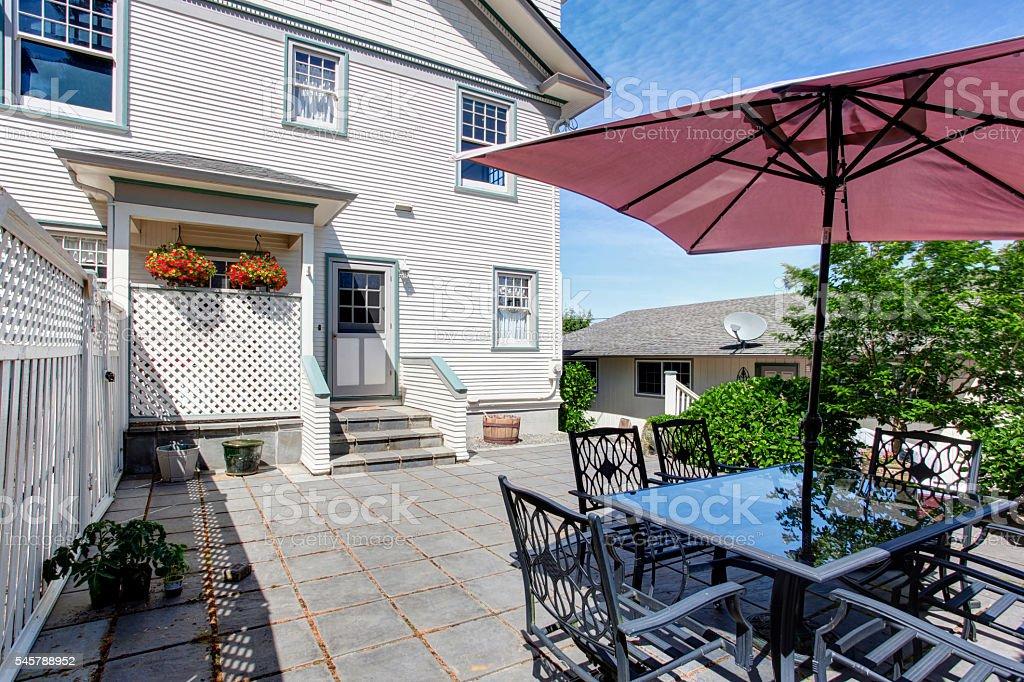 Concrete floor cozy patio area with table set stock photo