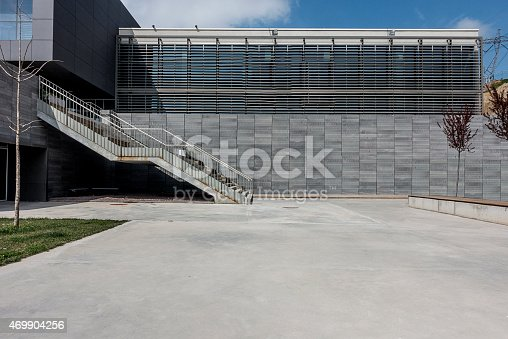 Concrete floor space with modern building wall