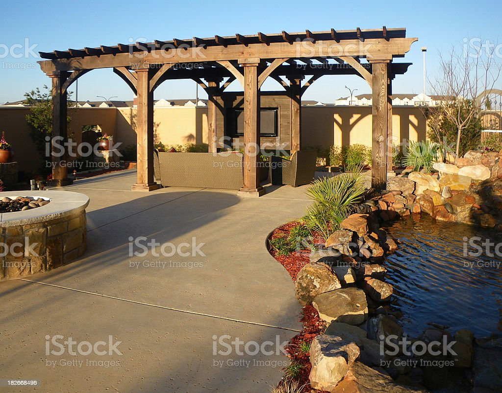 Concrete floors on an outdoor patio with koi pond and pagoda stock photo