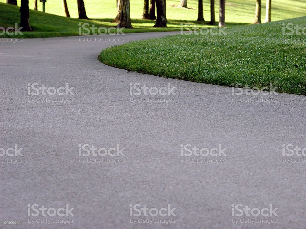 Concrete Footpath in a Park stock photo