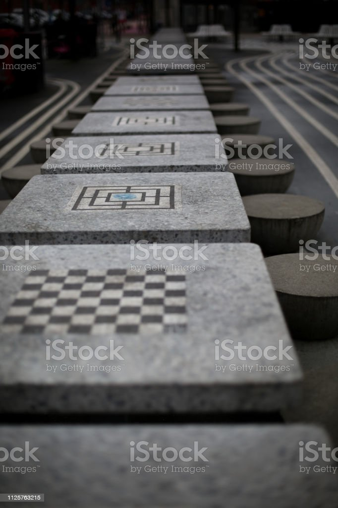 Chess boards on concrete tables in modern urban skate park