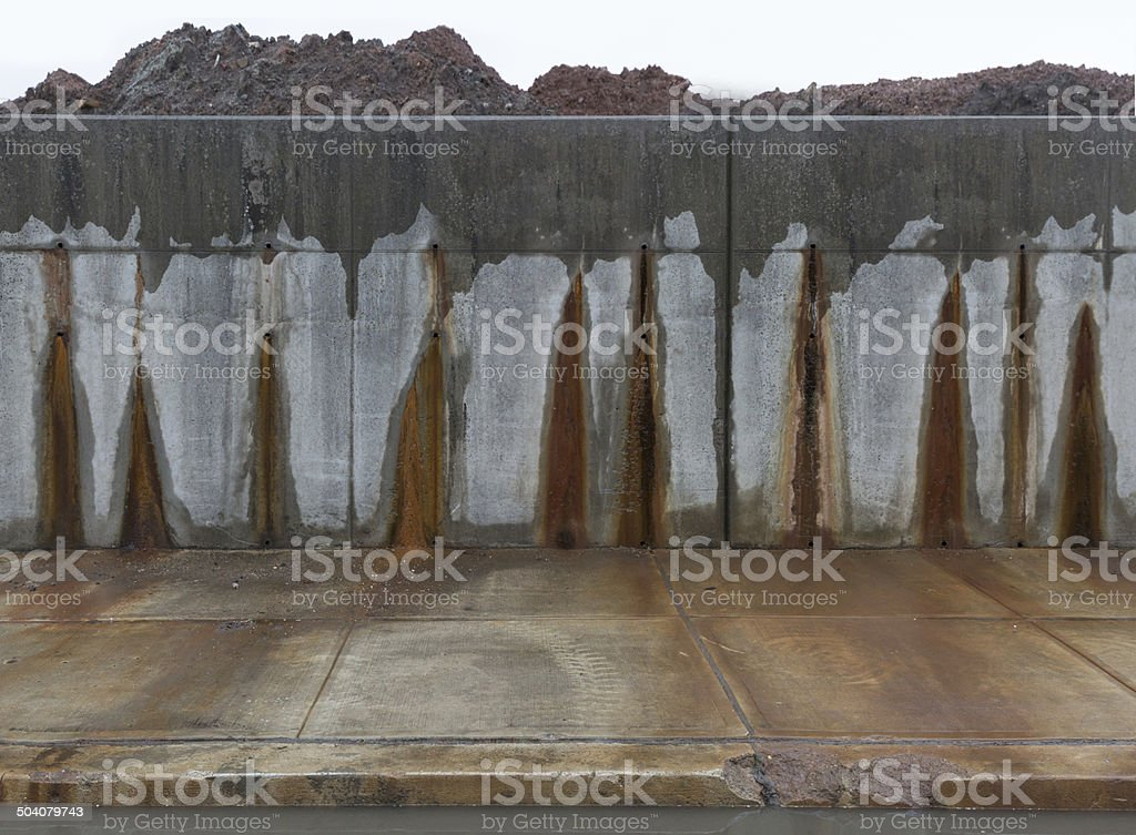 Concrete grey wall with red stains. stock photo