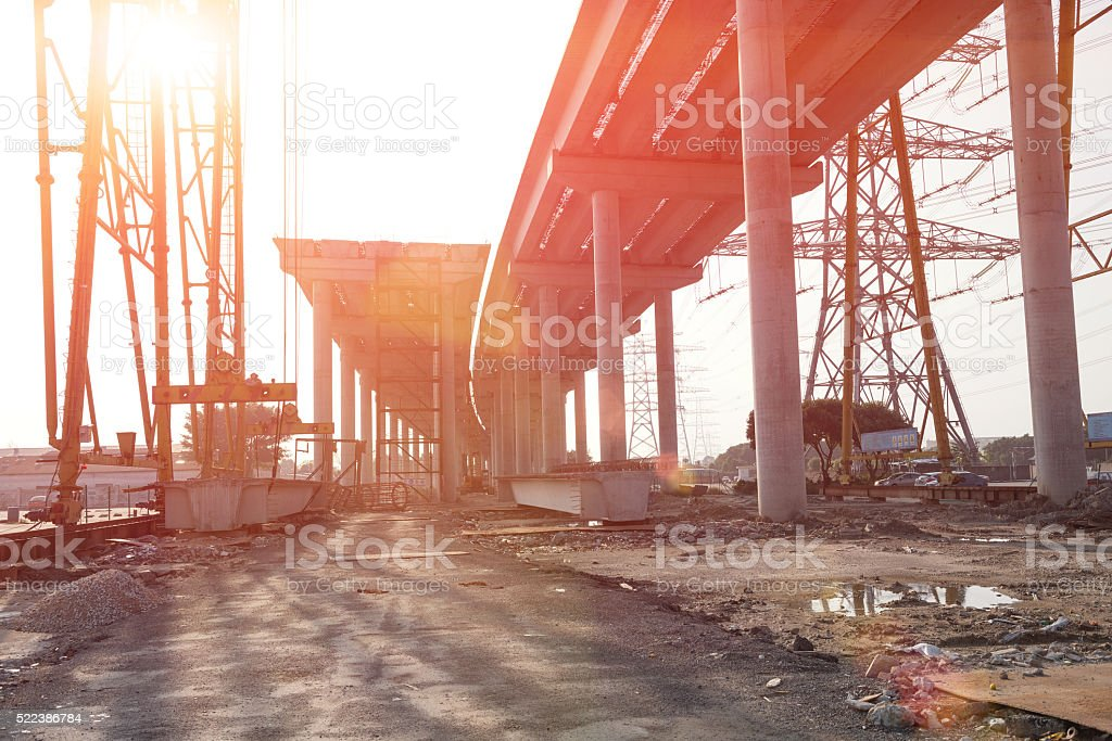 concrete highway under construction against the sun stock photo