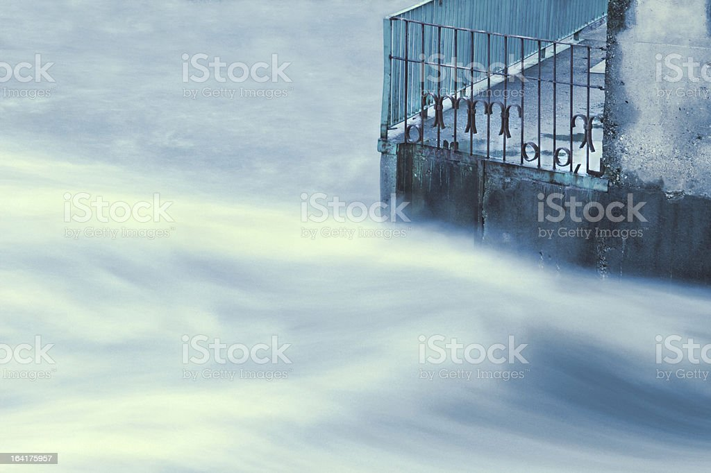 Concrete in flowing flood water royalty-free stock photo