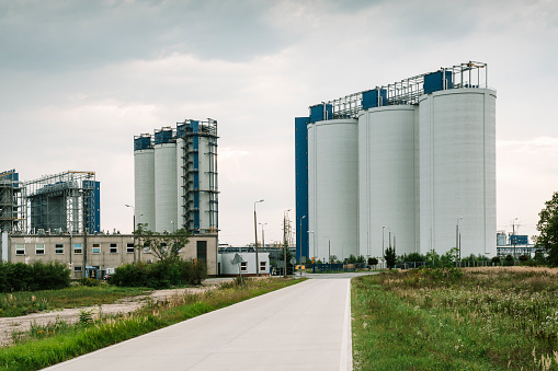 Concrete industrial ash silos near power station in southwest Poland.