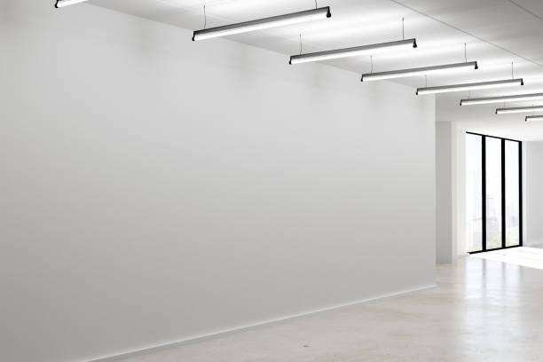 Concrete interior with empty wall stock photo