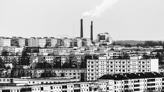 Soviet style apartment buildings and factory in background. Tartu, Estonia