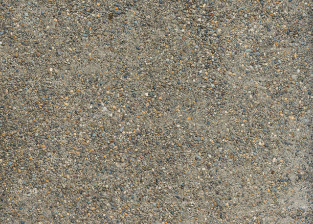 concrete mix with small gravel for background,Ready for product display montage. stock photo