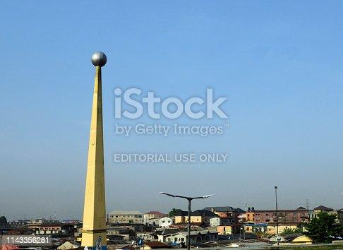 Lagos, Nigeria: concrete obelisk with globe - by the Third Axial Road, Abule Okuta / Oworosoki