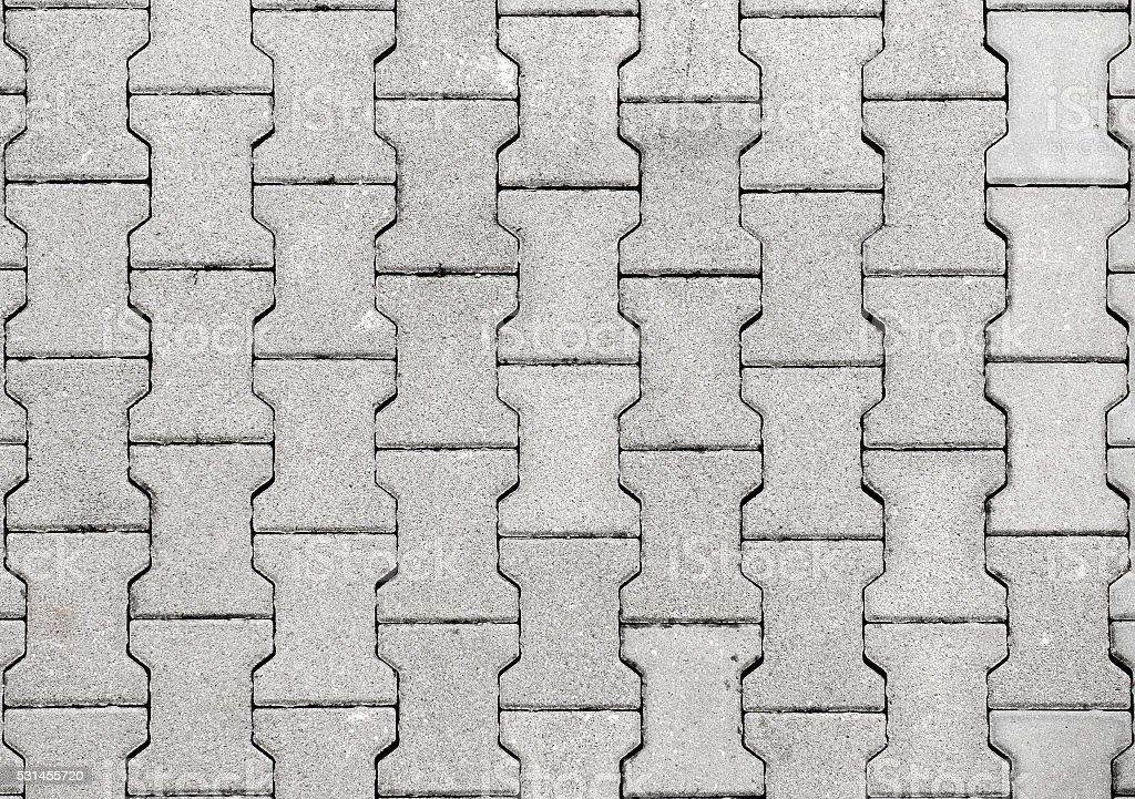 Concrete or cobble gray H Shaped  pavement slabs or stones. stock photo