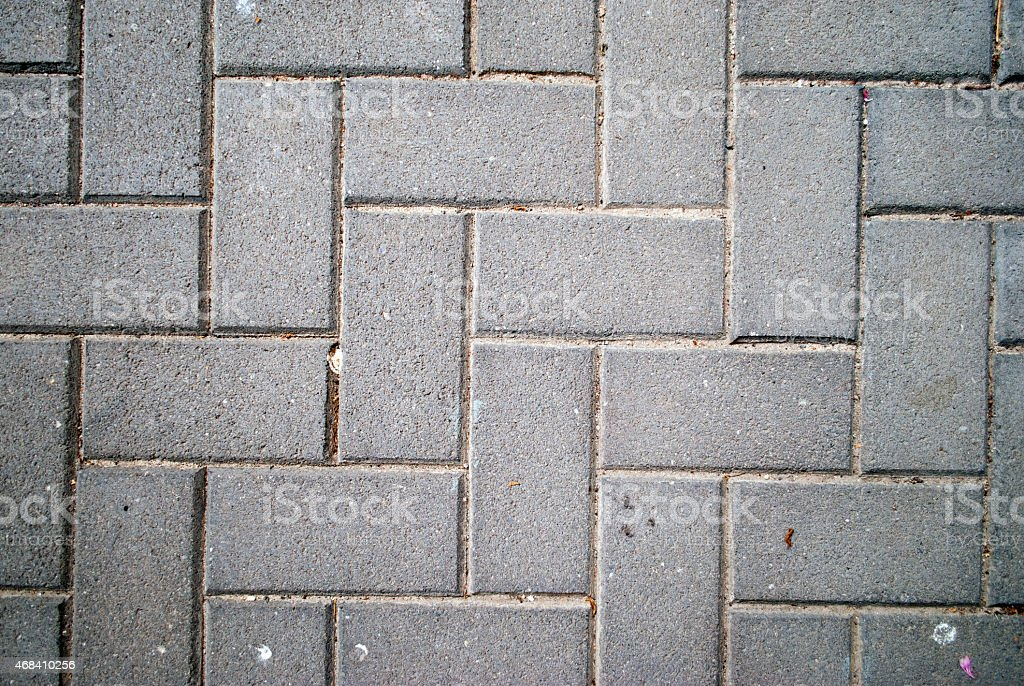 Concrete pavers in a herringbone pattern stock photo