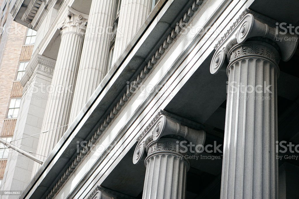 Concrete pillars on building in city royalty-free stock photo
