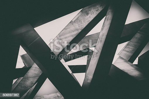 Abstract image of concrete pillars (detail of a building) in black and white.
