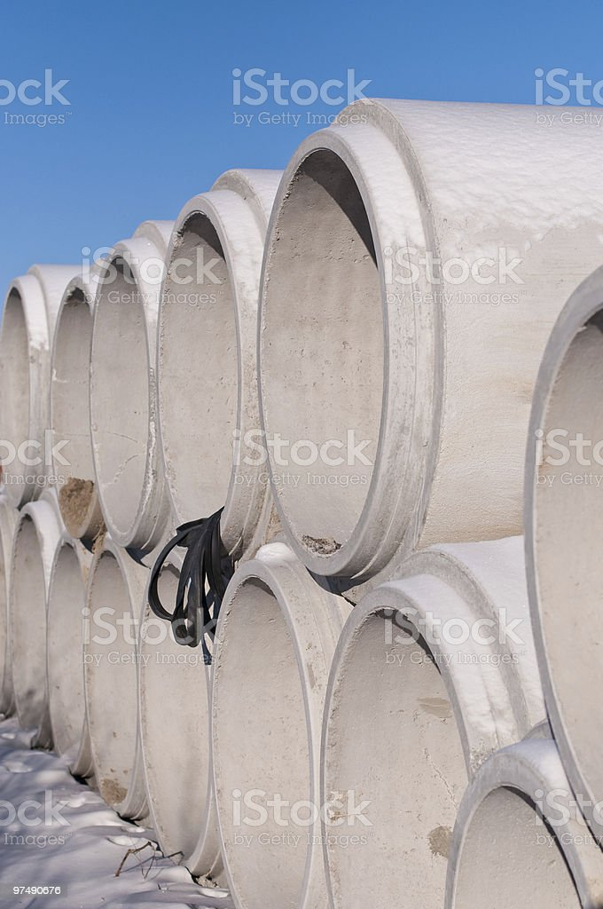 Concrete Pipes in the snow at a Construction Site royalty-free stock photo