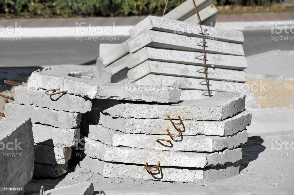 Concrete pit cover and curbstone stock photo