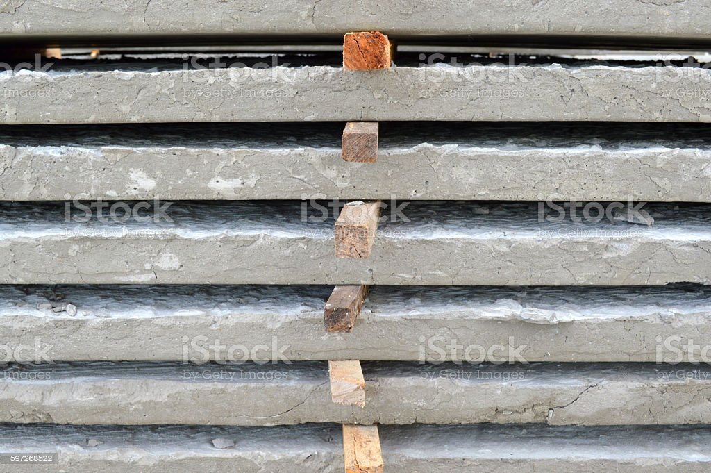 concrete plates laying on the ground at building site royalty-free stock photo