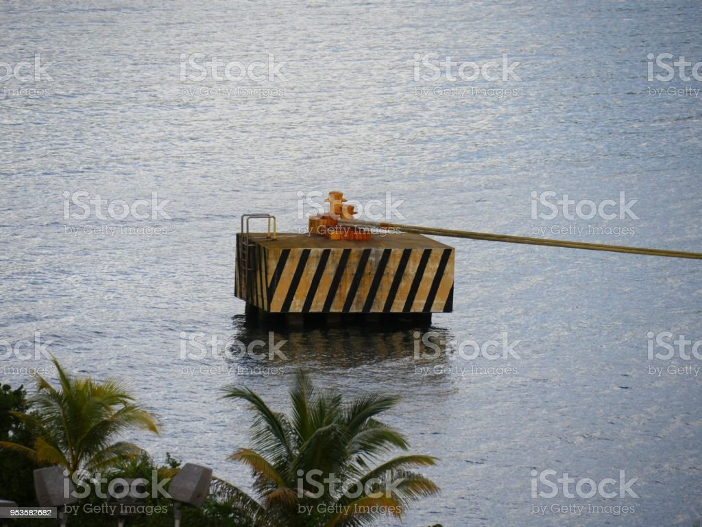 concrete platform with bollards where ropes are tied stock photo