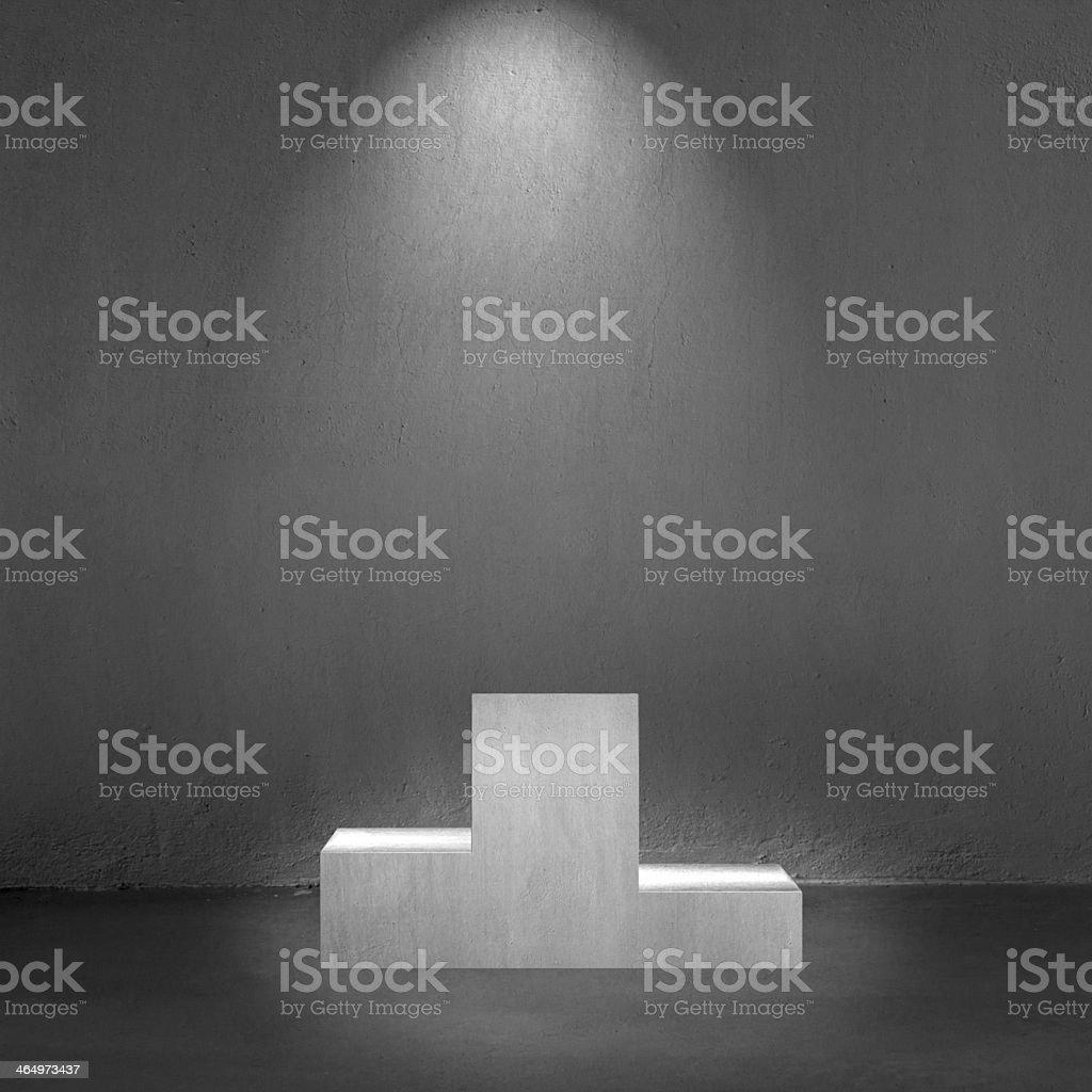 Concrete podium with spot lighting interior royalty-free stock photo