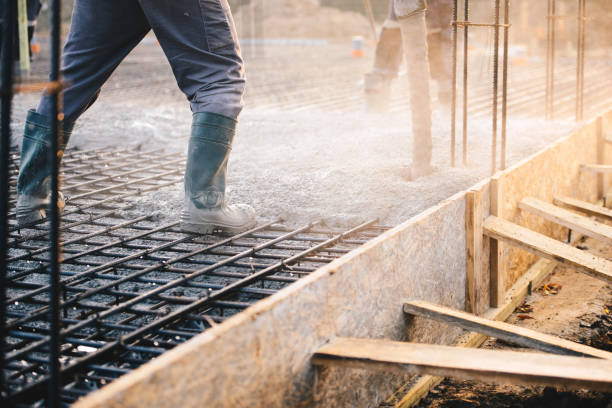 Concrete pouring during commercial concreting floors of buildings in construction stock photo